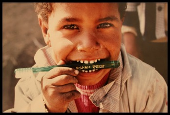 Photo of kid with toothbrush